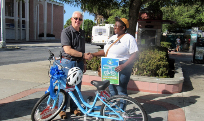 Gold Coast Transit District Presents Contest Winner with New Beach Cruiser